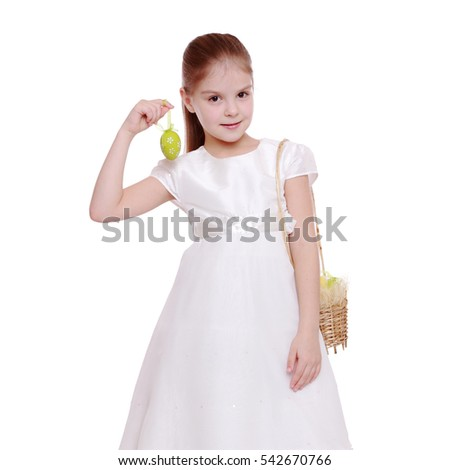 Girl in beautiful dress with Easter eggs isolated on white