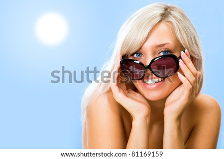 Girl in bikini and sunglasses on beach. - stock photo