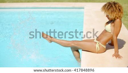 Girl in Bikini Swimsuit Relaxing in Swimming Pool - stock photo