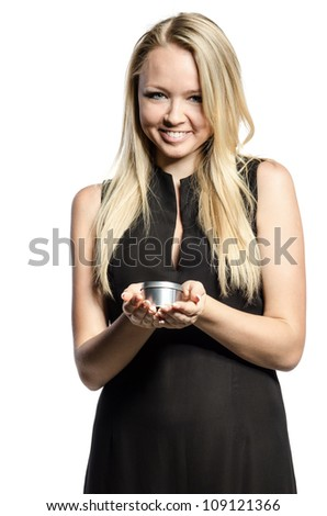 girl in black broadly smiles and holds the box - stock photo