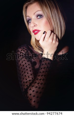 Girl in black dress and make-up