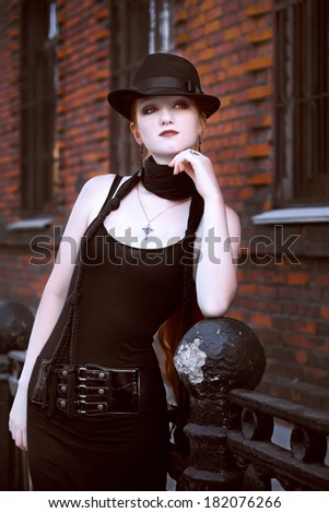 Girl in black dress and red lenses - stock photo