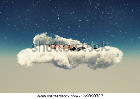 girl in black lingerie lies on a cloud sleeps - stock photo