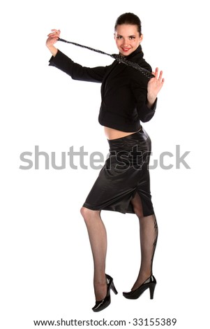 Girl in black suit demostrating necktie. Isolated on white.