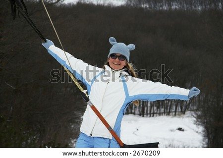 Girl in blue clothing on lift - stock photo