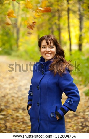 Girl in blue coat at autumn park