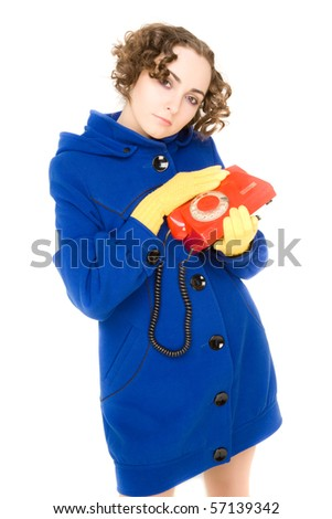 Girl in blue coat with old red telephone