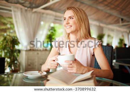 Girl in cafe - stock photo