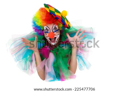 Girl in cap and clown costume with a bouquet of flowers puts out the tongue looks up isolated on white background. - stock photo