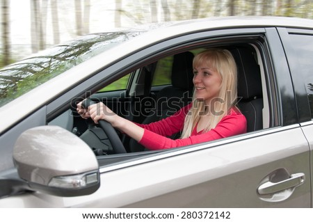 Girl in car, view front of door - stock photo