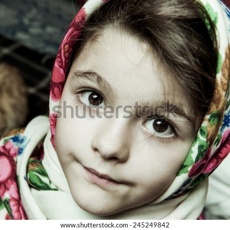 Girl in colorful scarf looking at the camera. - stock photo