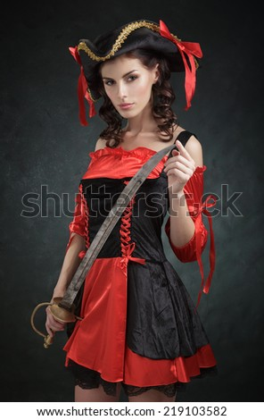 Girl in costume pirate with a sword - stock photo