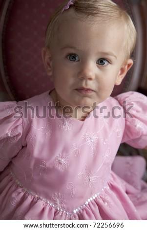 Girl in cute pink dress - stock photo
