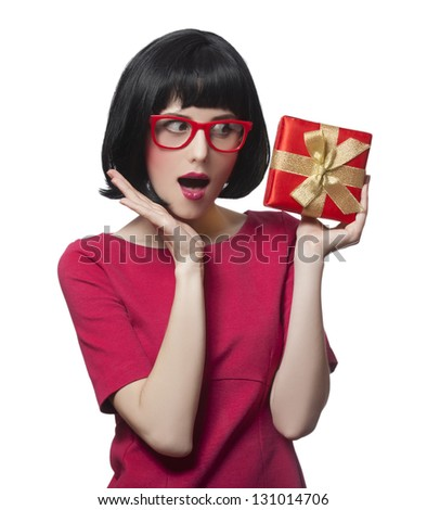 girl in dress with present box at white background.