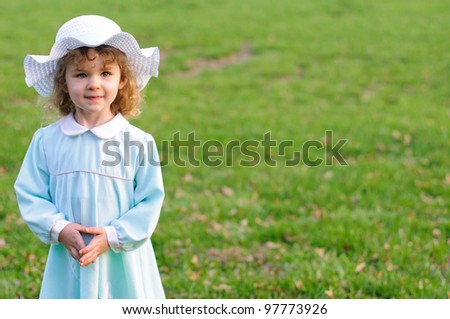 Girl in Easter Dress and Bonnet - stock photo