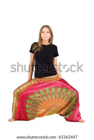 Girl in ethnic clothes studio shot
