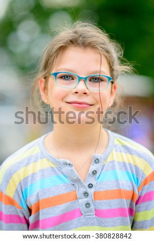Girl in eyeglasses with disheveled hair and - portrait full of positive emotions  - very shallow depth of field - stock photo