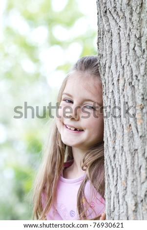 Girl in forest hiding