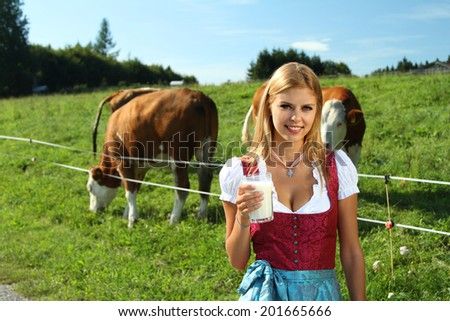 girl in front of a meadow - stock photo