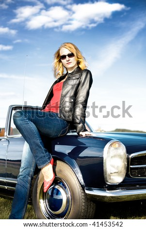 Girl in front of Post-War classic car - stock photo
