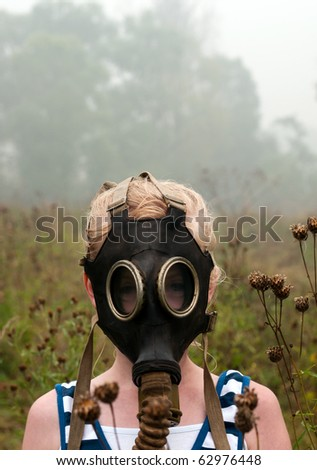 girl in  gas mask - stock photo
