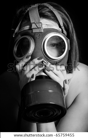 Girl in gasmask on black and white - stock photo