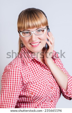 girl in glasses calls by telephone - stock photo