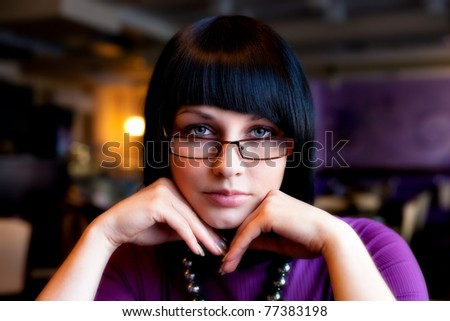 girl in glasses in cafe - stock photo