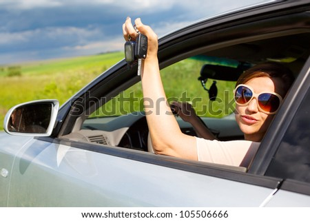 girl in glasses with the keys to the car