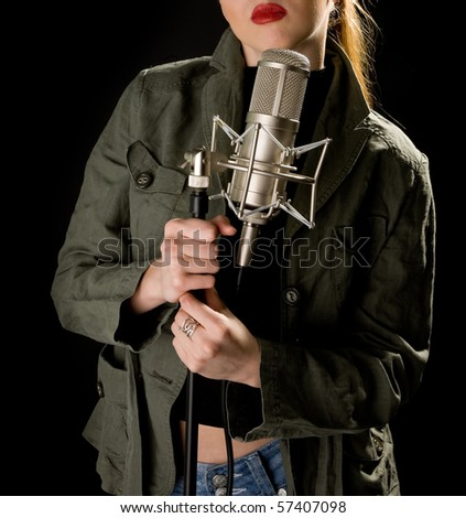 Girl in green holding microphone - stock photo