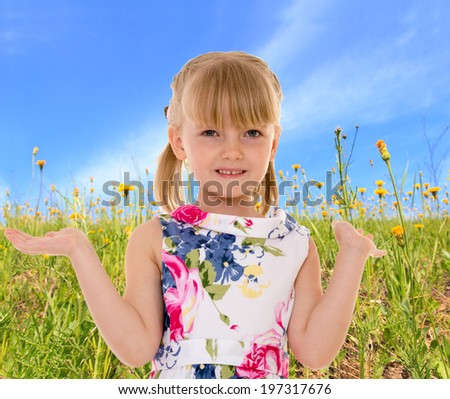 Girl in green meadow - stock photo
