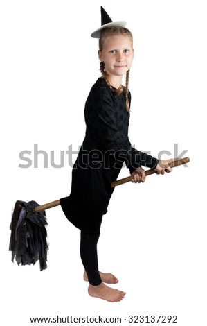 girl in halloween costume of witch with broom isolated on white background - stock photo