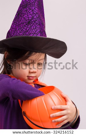 Girl in Halloween Costume on White / Girl in Halloween Costume / Girl in Halloween Costume, Studio Shot - stock photo