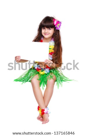 Girl in hawaiian dress sitting on white cube and holding the small blank  isolated on white - stock photo