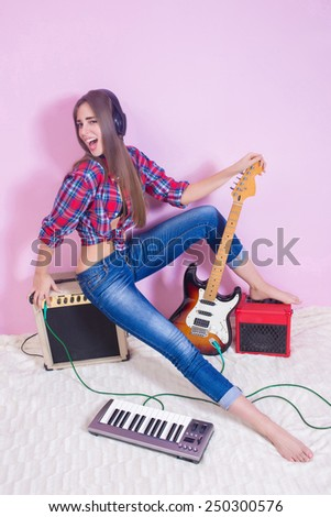 girl in headphones listens to music. electric. - stock photo