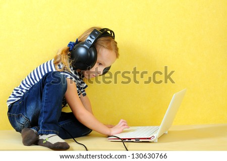 girl in headphones with a laptop - stock photo