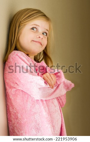 Girl in her jammies with a big smile on her face before she goes to bed. - stock photo