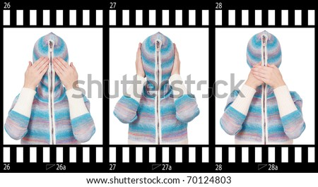 Girl in hood with no face. See no evil, hear no evil, speak no evil. - stock photo