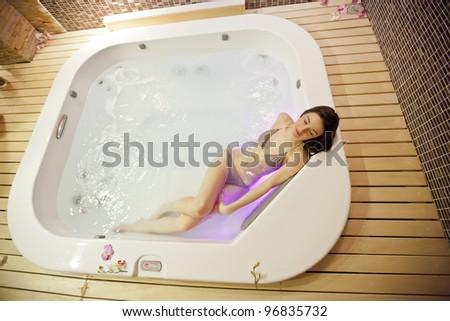 Girl in jacuzzi - stock photo