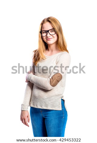 Girl in jeans and sweatshirt, young woman, studio shot - stock photo