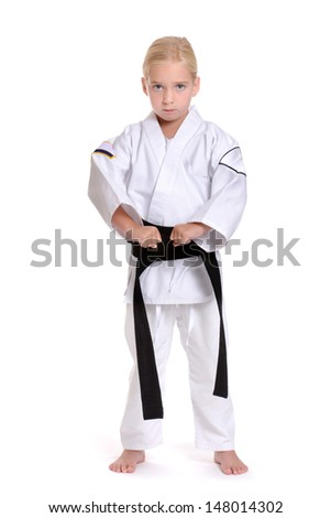 girl in karate uniform white background - stock photo