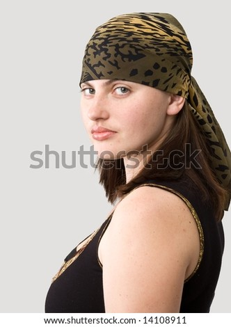 girl in kerchief on a grey background