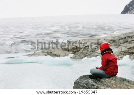 girl in meditation at Jostedalsbreen glacier - stock photo