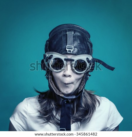 Girl in pilot helmet