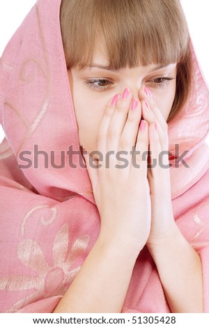Girl in pink scarf prays, isolated on white background.