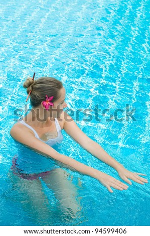 girl in pool relaxing