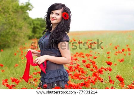 Girl in poppy field - stock photo