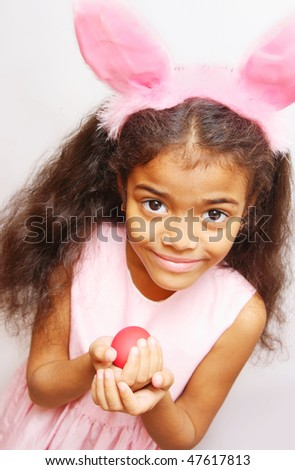 girl in rabbit costume with easter egg in her hands