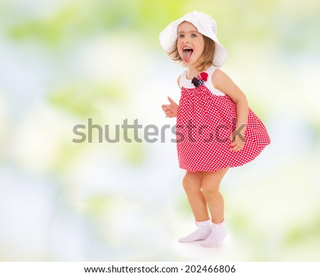 girl in red dress fun stuck out her tongue.cheerful summer holiday,active lifestyle,happiness concept,carefree childhood concept.