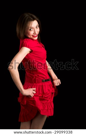 Girl in red dress twisting and turning